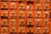 Red drawer of old fashioned chinese cabi — Stock Photo