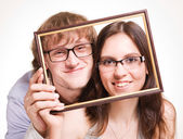 Happy pair in glasses in frame — Stock Photo