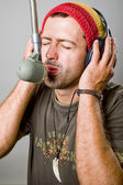Young man singing in microphone — Stock Photo
