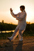 Woman in white suit make — Stock Photo