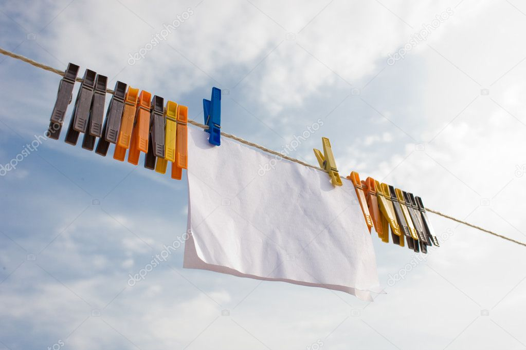 A piece of paper hanging on cord with clothespins oposite sky background 9 — Stock Photo #1272740