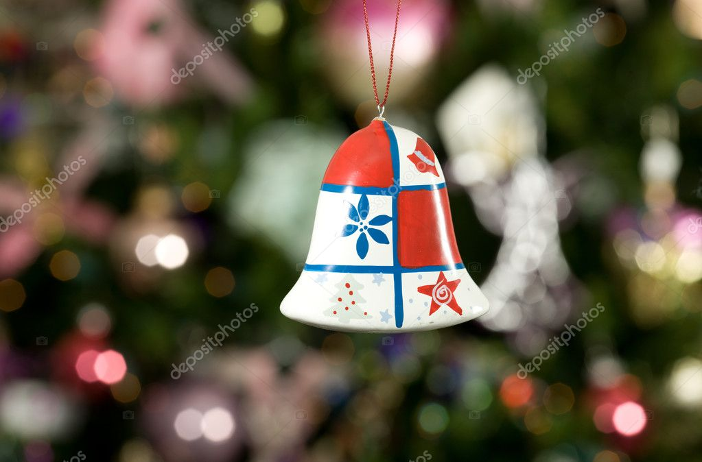 Christmas bell with tree and lights on background  Stock Photo #1272775