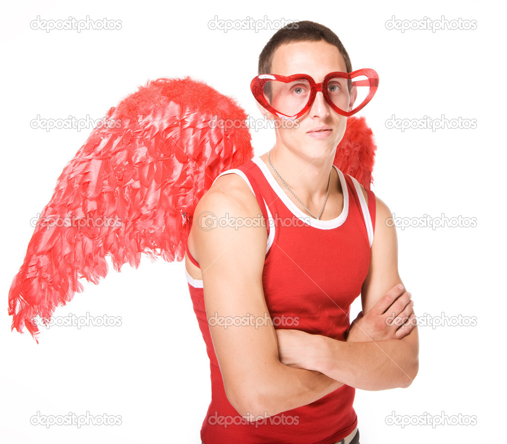 Young man smiles in red heart-glasses with wings on his back — Stock Photo #1273560