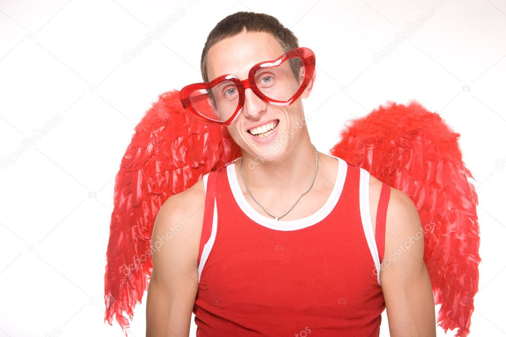 Young man smiles in red heart-glasses with wings on his back — Stock Photo #1273571