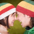 Pair in reggae hats that  scream — ストック写真