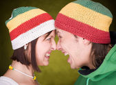 Pair in reggae hats that scream — Stock Photo