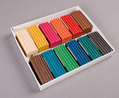 Multi colored plasticine in box on grey — Stock Photo