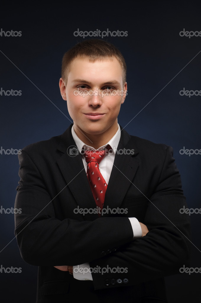 Porttrait of businessman over dark background — Stock Photo #2605579