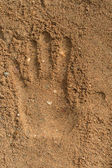 Fingerprint hand on the sand — Stock Photo