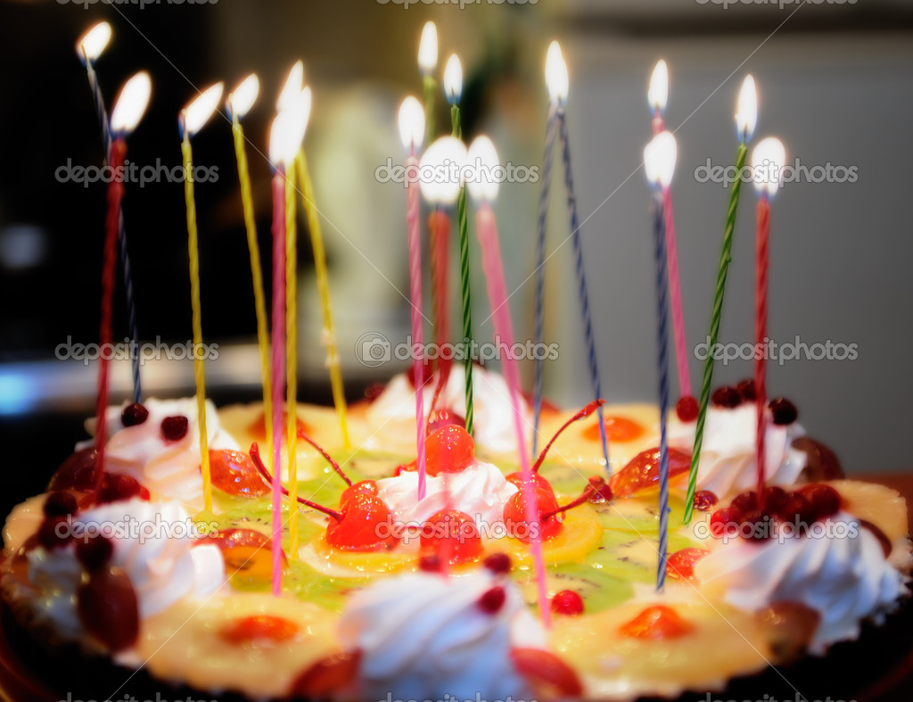 A birthday cake with lighted candles  Stock Photo #1294046