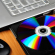 Laptop with disk - Stock Photo