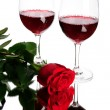 Stock Photo: Red wine and rose