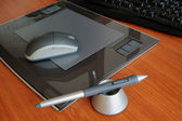 Graphic tablet with pen and mouse — Stock Photo