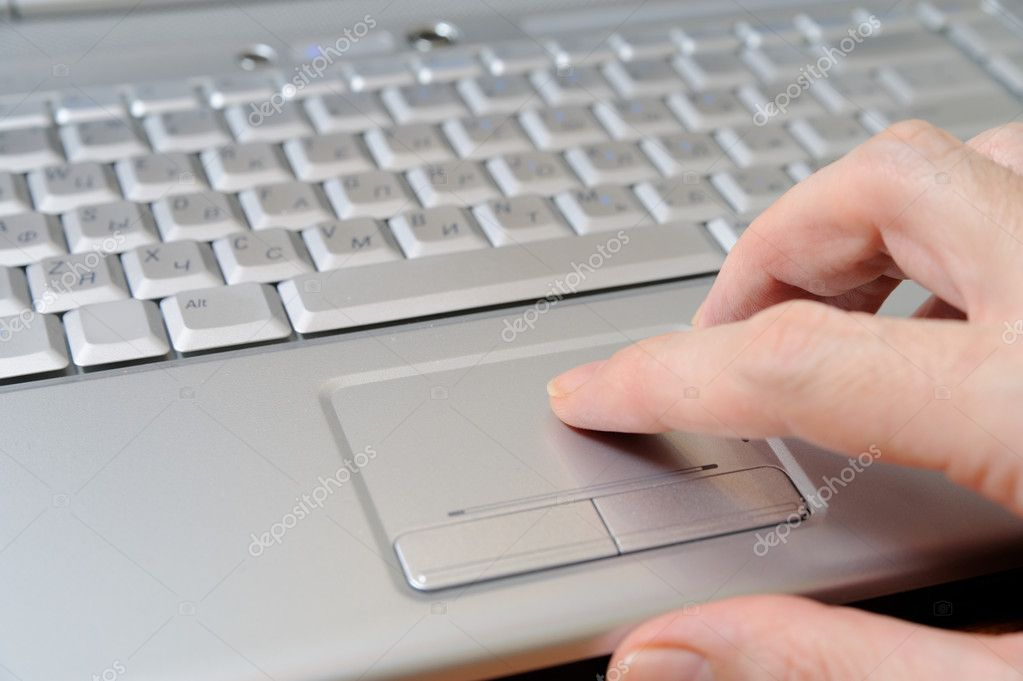 A businessman using the touch pad on the laptop  Stockfoto #1317191