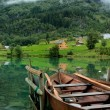 Wooden boat on fjord — Stock Photo