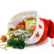 Christmas hat with toys on white — Stock Photo #1221329