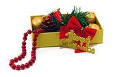 Christmas box with toys on white — Stock Photo