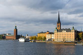 Old city on water skyline — Stock Photo