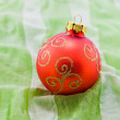 Stock Photo: Christmas-tree ball on green textile
