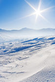 Snowcovered mountains under blue sky — Stock Photo