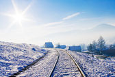 Railroad in snow covered mountains — Stock Photo