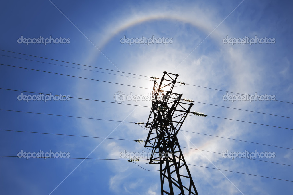 Amazing sun halo above high-voltage power supply network  Stock Photo #1352072