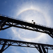 Amazing sun halo above bridge — Photo
