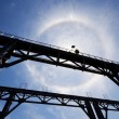 Amazing sun halo above bridge — Stock Photo