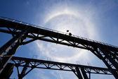 Amazing sun halo above bridge — Stock Photo