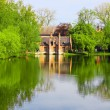 Stock Photo: Old brick house on water in park
