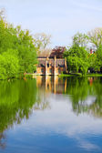 Old brick house on water in park — Stock Photo