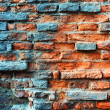 Old obsolete rusted red brick wall - Stock Photo