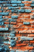 Old obsolete rusted red brick wall — Stock Photo