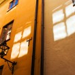 Window reflections on old town walls - Stock Photo