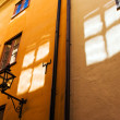 Stock Photo: Window reflections on old town walls