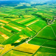 Aerial view of rural landscape under sky — ストック写真