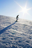 Mountain Skiing under blue sky — Stock Photo