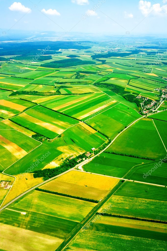 Aerial view of green rural landscape under blue sky  Stock Photo #1986075