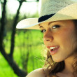 Portrait of beautiful cowgirl in hat - Stock Photo