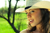 Portrait of beautiful cowgirl in hat — Stock Photo