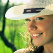 Portrait of young woman cowgirl in hat - Stock Photo