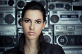 Beautiful woman with Boom Box background — Stock Photo