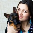 Portrait of beautiful woman with dog — Stock Photo