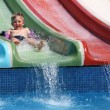 Stock Photo: Boy slides waterslide.