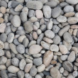 Stock Photo: Smooth river stone background.