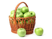 Basket with green apples. — Stock Photo
