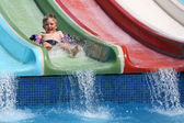 The boy slides a waterslide. — Stock Photo