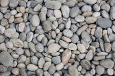 Smooth river stone background. — Stock Photo