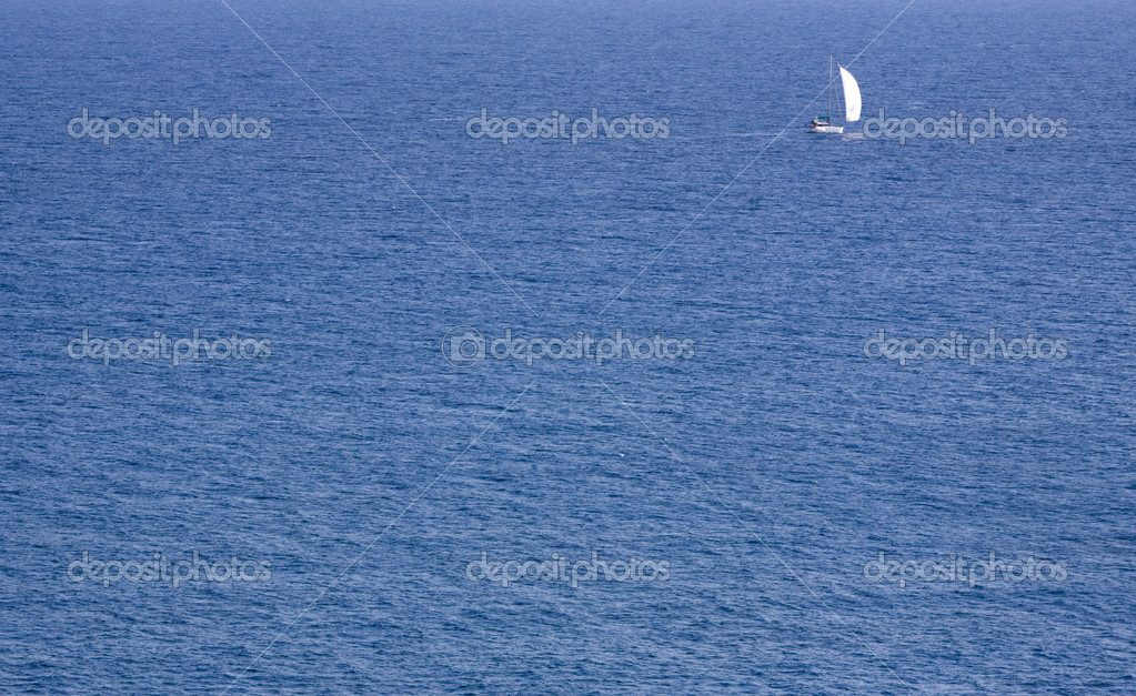 Background with small sailing vessel in the high sea.  Stock Photo #1474753