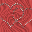 Interweaving two pearl hearts — Stock Photo